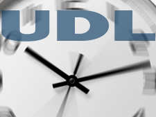 "Clock is featured in the background with the words ""UDL"""