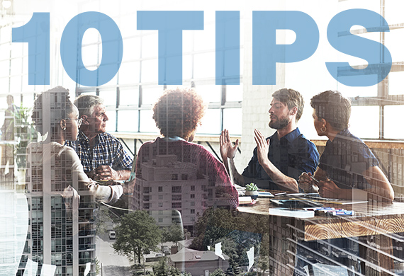 "Instructors collaborate around table with the words ""10 Tips"" overhead"