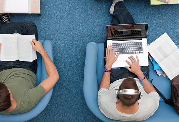 People sit in comfy chairs while reading and browsing the internet