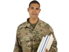 Person in military gear holds notebooks