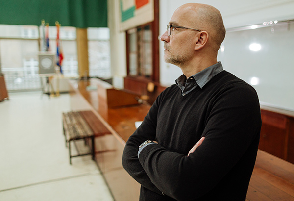 Instructor looks out into empty classroom