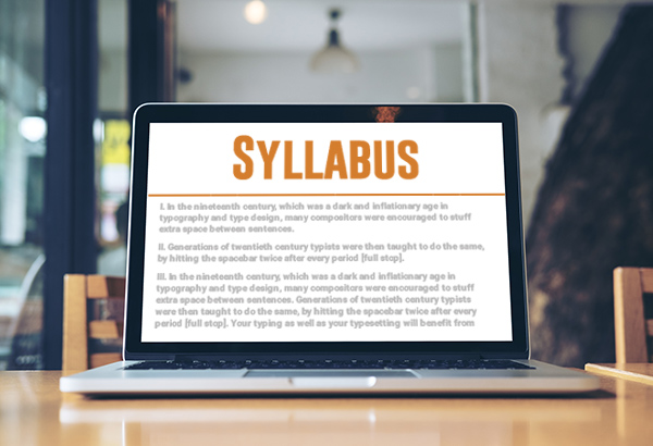 Computer is open with syllabus pulled up on screen