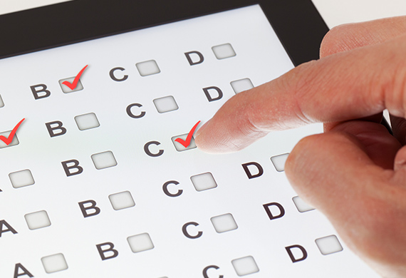 Multiple choice exam is available via tablet and hand clicks on correct answer