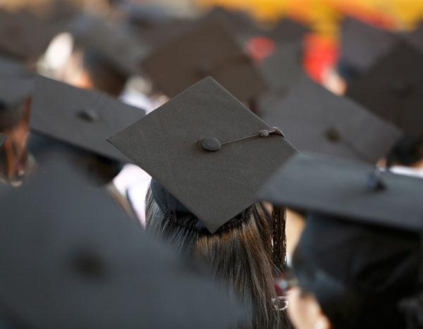 Graduation caps fill the room