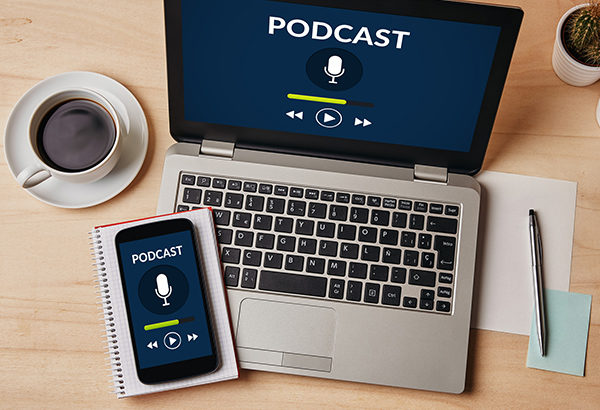 Podcast icon and clip is featured on computer screen and phone