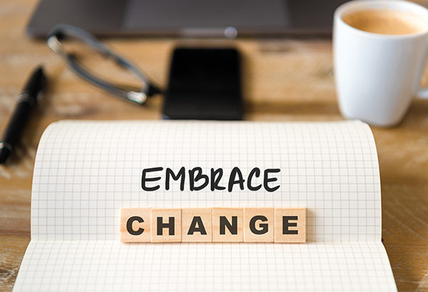 "Piece of paper says the words, ""Embrace change"""