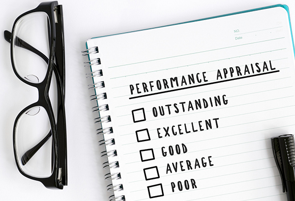 """Notepad has the words, """"performance appraisal"""" with checkboxes that indicate outstanding, excellent, good, average, or poor"""
