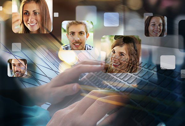 Person types on computer keyboard with images of people displayed in the forefront