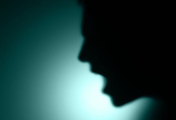Shadow figure screams with mouth open