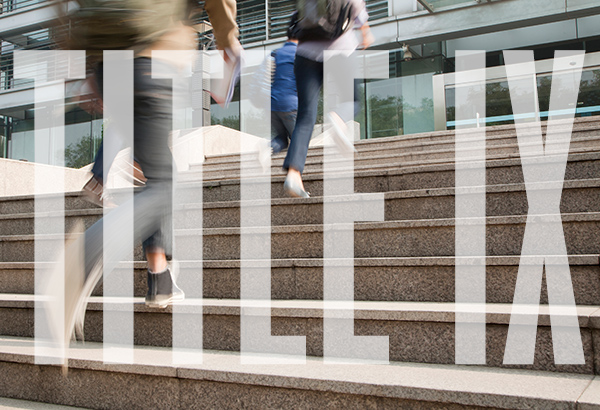 Title IX is displayed in front of stairs leading to university