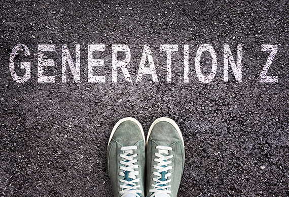 Shoes stand on pavement with Generation Z written above