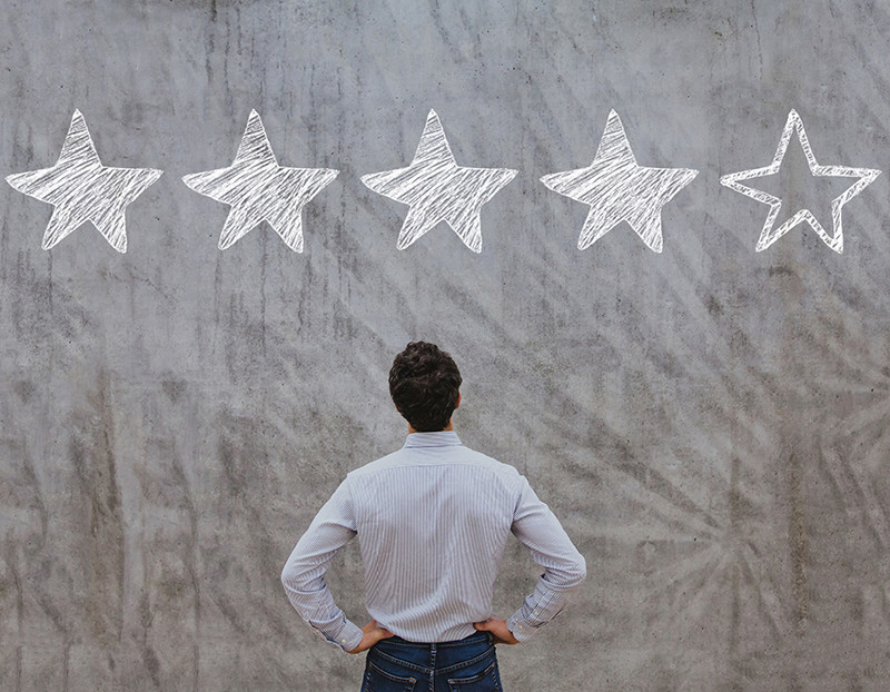 Person looks above him at four out of five stars colored in