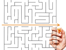 Maze with hand drawing arrow out