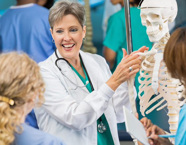 Doctor displays fake skeleton to nursing students