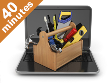 Toolkit with tools sits on top of laptop
