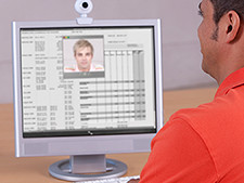 Person looks at profile of person on computer