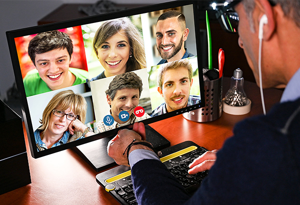 Instructor sets up Zoom meeting for online course