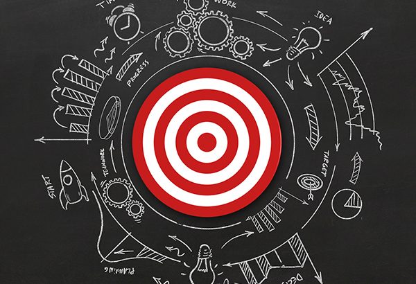 Bullseye on chalkboard represents aligning educational assignments