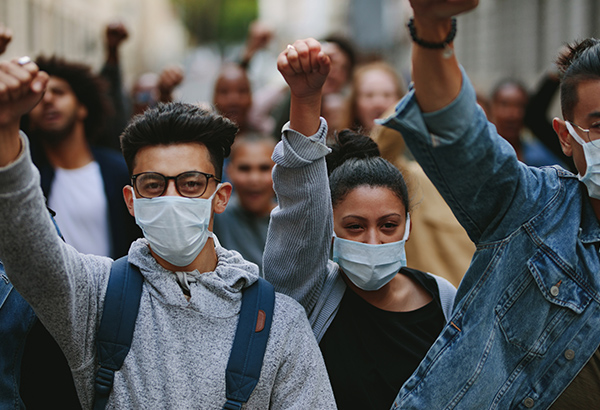 Students come together in protest and masks during times of crisis
